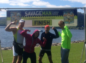 Tara and Craig, along with their dads, Ed and Roy, after the finish of the 2013 Savageman Triathlon